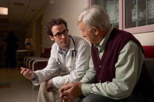 Doctor talking to man
